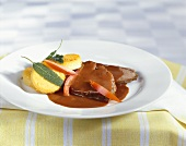 Braised beef with polenta cakes and sage