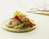 Poached sea fish on herb sauce