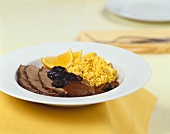 Leg of lamb with plum sauce and orange rice