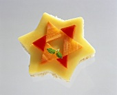 Star-shaped open cheese sandwich with pepper and carrot