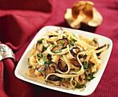 Ribbon pasta with mushrooms and parsley
