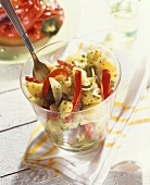 Potato salad with peppers, gherkins and herb dressing