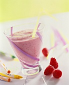 Raspberry shake for children, wax crayons beside it