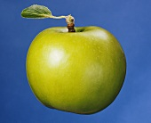 A green apple with leaf