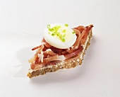 Canapé: strips of bacon & slice of egg on wholegrain bread