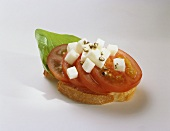 Canapé: tomato, mozzarella and basil on slice of baguette