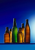 Assorted beer bottles against blue background