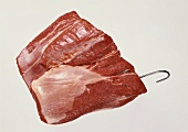 A piece of beef on a meat hook