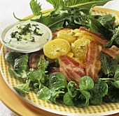 Corn salad with dandelion leaves, potatoes and bacon