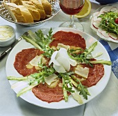 Beef carpaccio with asparagus and rocket