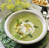 Vegetable cream soup with sour cream, croutons and herbs