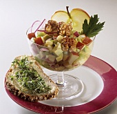Spicy apple salad with walnuts, cress on bread & butter