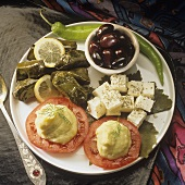 Appetiser plate with stuffed vine leaves, sheep's cheese etc.