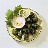 Stuffed vine leaves with yoghurt sauce
