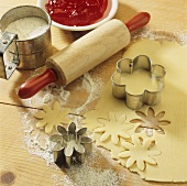 Baking scene with pastry, biscuit cutters, rolling pin