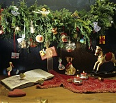 Advent calendar with sweets on garland of fir branches