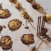 Almond thins & almond & candied peel clusters on baking parchment