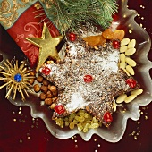 Star-shaped spice cake with Christmas decorations