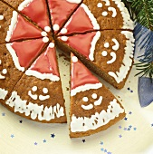 Round gingerbread decorated with Father Christmas faces
