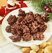 Chocolate almond clusters on a plate