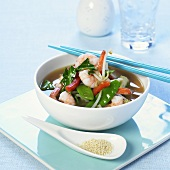 Shrimp and vegetable soup in a bowl