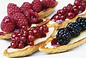 Sweet pastry boats filled with fresh berries
