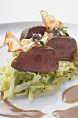 Roast venison fillet on white cabbage
