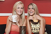 Two blond girls in café