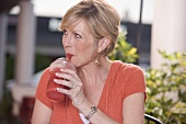 Woman drinking a frozen strawberry smoothie