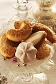 Biscuits (vanilla crescents, meringues) on glass stand