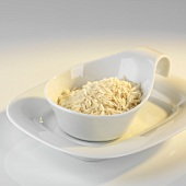 Portion of uncooked rice in a small bowl
