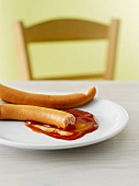 Frankfurters with ketchup