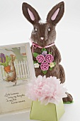 A chocolate Easter Bunny with Easter card and gift