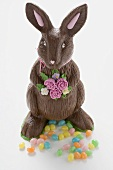 A chocolate Easter Bunny with colourful Easter sweets