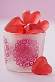 Red, heart-shaped jelly sweets in a glass