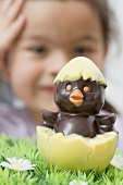 A chocolate chick hatching out of an egg (Easter)