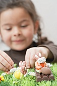 A girl playing with chocolate figures