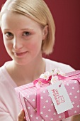 Young woman with a gift for Valentine's Day