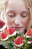 Young woman with bouquet of chocolate-dipped strawberries