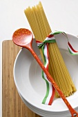 Spaghetti with Italian ribbon and cooking spoon