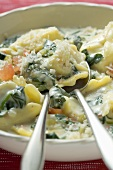 Pasta with spinach & cream sauce, diced tomatoes & Parmesan