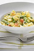 Farfalle with green asparagus, peas and diced tomatoes