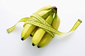 Bunch of bananas with a tape measure