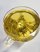Thyme tea in a glass cup