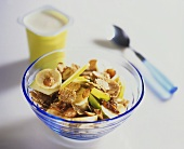 Muesli with apple, banana, almonds and yoghurt