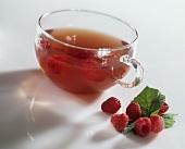 Raspberry tea in a glass cup