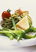 Green ribbon pasta, beans, Parmesan, saffron and tomato