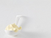 Double cream on a spoon