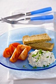 Diet breakfast: wholemeal bread, herb quark and tomatoes