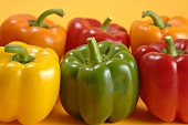 Six peppers of various colours
